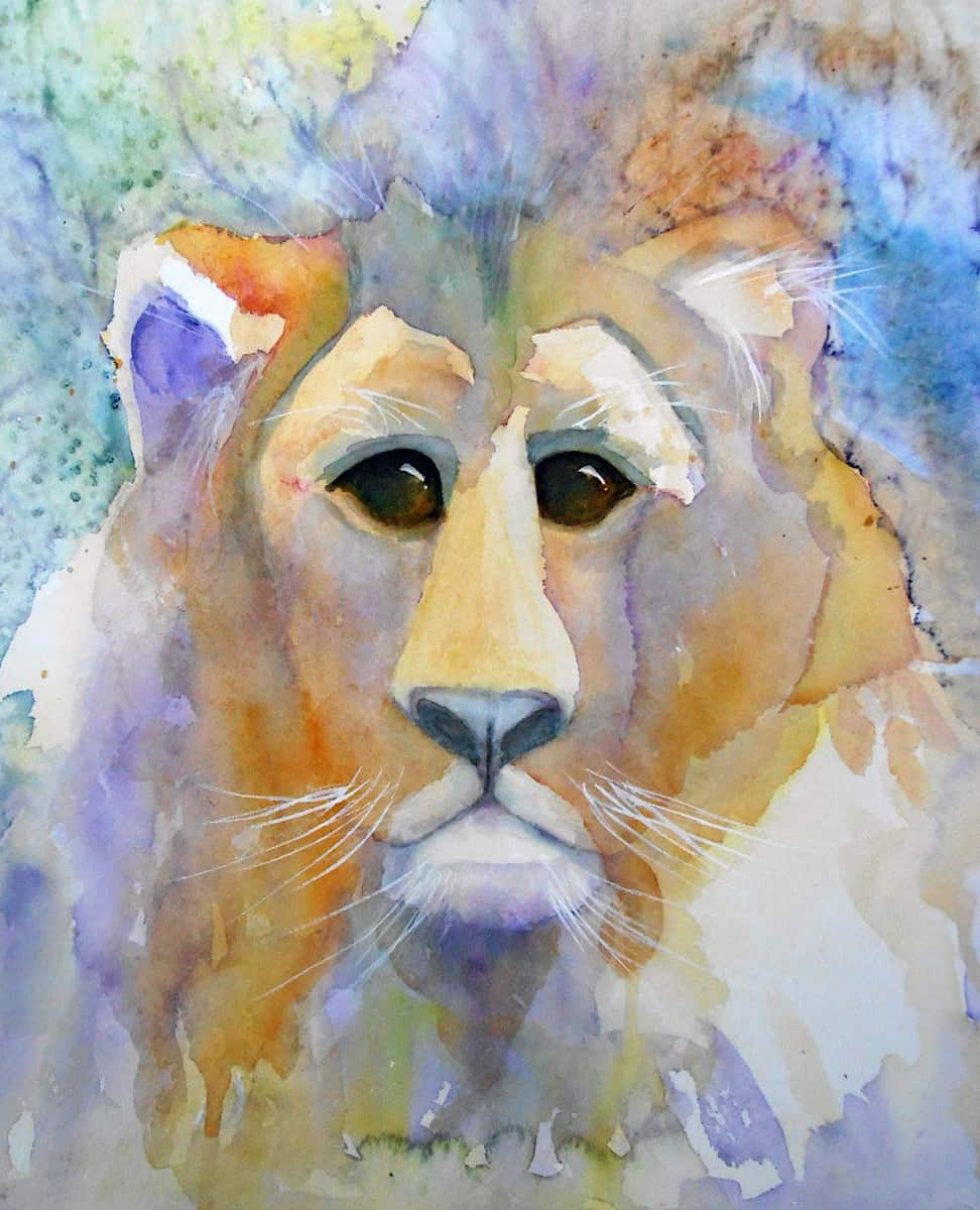 Lion face and mane in blue yellow orange and green watercolour by Katie Lloyd