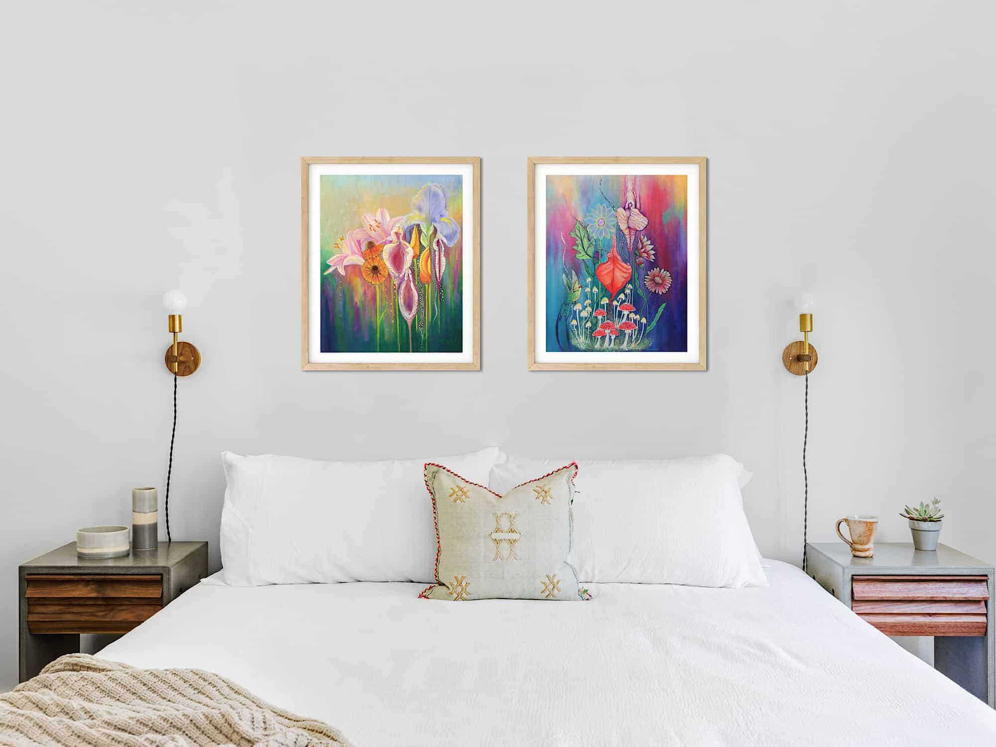 Yoni nectar and Procreate paintings hanging above a bed